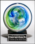 "7""H Art Glass Disk AwardGlass disk with blue and green accents on a black crystal  base. Seven inches in total height.Includes a gift box and an engraved or sublimated plate for the base. New item!Call 800-830-3386 to buy now!"