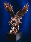 14H Attacking Eagle This finely detailed sculptured 14 Antique Copper Finished Eagle is perched on an Ebony presentation base. Personalize with matching copper plate.New item!Call 800-830-3386 to buy now!