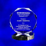 Clear Acrylic Multi-Faceted Octagon Paperweight Award. The cut jewel effect created by the multi-facets hand polished in this clear acrylic desk item makes for a perfect paperweight and/or award. Personal message is lasered to precision.Set-up and Etching Charge $35Additional Units $15