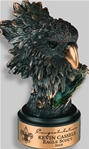 This Bronzetone Eagle Head is small yet fierce. The beak is a brilliant bronze finish. This elegantly antiqued finished figurine is on a round ebony base. A metal tone plate is provided for personalization.Additional Charges For Engraving and Logos
