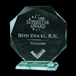 Jade Crystal Faceted Circular Octagon Award. Presented handsomely on a matching Beveled Jade Crystal Base. Hand-cut beveled edges highlight each elegant piece. Detailed reverse etching proudly adds dimension to the honor.Set-up and Etching Charge $50Additional Units $25