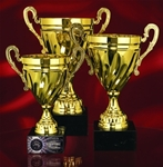 Classic elegance and timeless recognition is accomplished with this Italian style Gold Twisted Metal Trophy Cup. Solid Black Marble Base provides sound footing for this truly tradtional engraved award.Additional Charges For Engraving and Logos