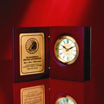 Very Elegant Hinged Award or Gift in presentation Book Form. This 5 ½� Book Clock with Hand-rubbed Rosewood finish displays timeless beauty and is ideal for commemorating superior accomplishments and milestones. Brass inlayed engraving plate is ideal for communicating warm sentiments.