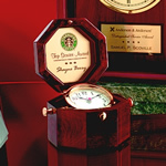 "Elegant Solid Rosewood Octagonal Box ""Captains� Clock features Gleaming Brass Tilting Alarm Clock and Richly Engraved Brass Plate inside Hinged Lid. A Timeless Keepsake that sits 4 high when closed."